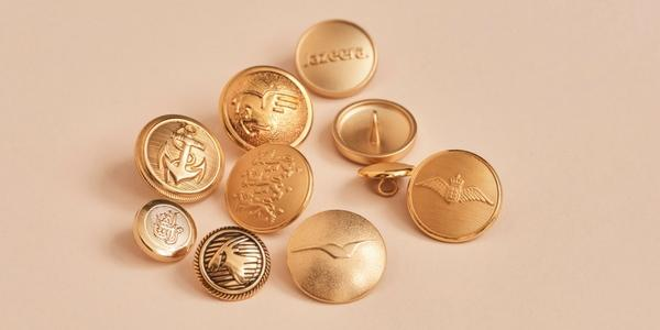 Customised gold uniform buttons